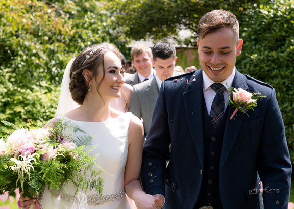 Atlanta and Luke's beautiful wedding at Comlongon Castle with a brilliant real story of how they met in their ceremony